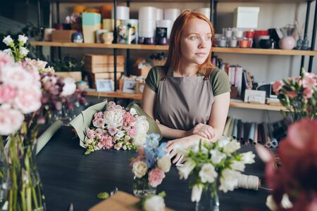 Florist waiting for customer in flower shop