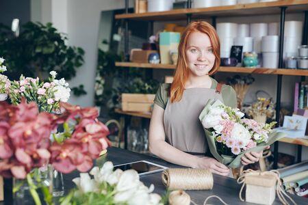 Happy florist in own shop 写真素材