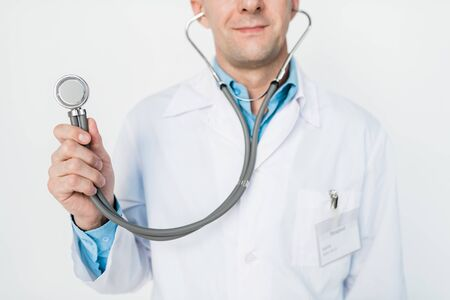 Hand of young contemporary doctor holding stethoscope in front of camera Imagens