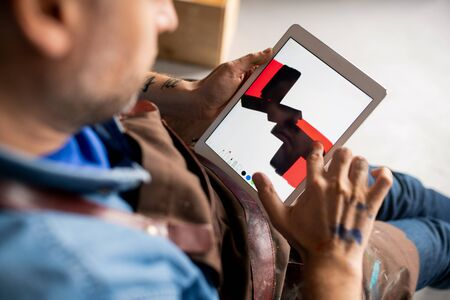 Contemporary artist painting something abstract on touchpad display Banco de Imagens
