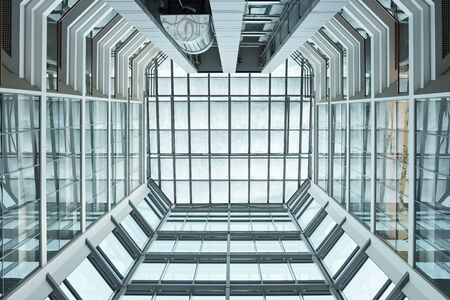 View of interior of contemporary office building made up of glass that can be used as background Фото со стока
