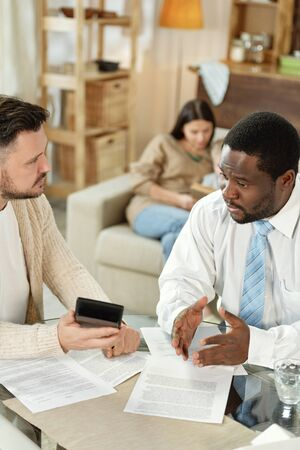 Black man helping client with loan calculation