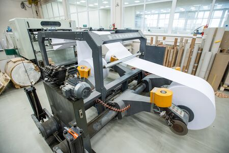 Powerful printing press with roll paper used for producing newspaper at modern factory
