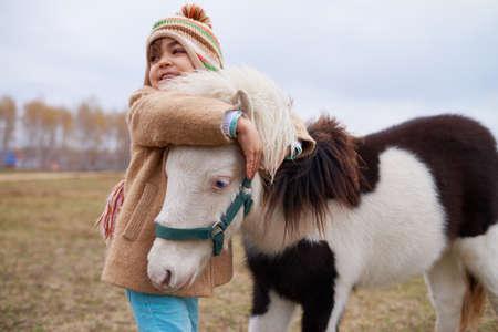 Happy Girl Hugging Little Pony