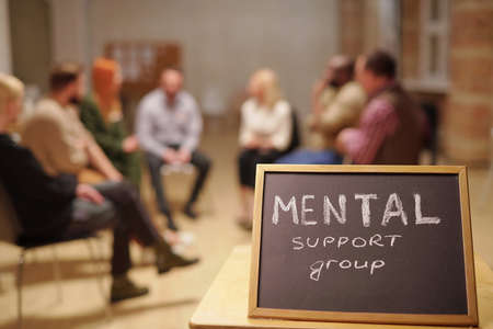 Small blackboard saying about mental support group against patients