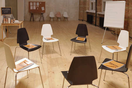 Several chairs with mental support group journals