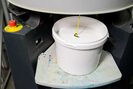 Plastic bucket with white paint for household needs