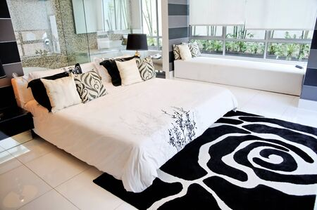 king bed: Spacious master bedroom in a luxury condominium
