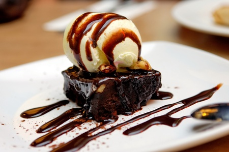 dessert plate: Chocolate brownie with vanilla ice-cream and chocolate sauce Stock Photo