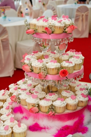 Neatly arranged wedding cup cakes Stock Photo