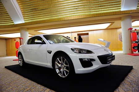 crossover: Mazda RX-8 coupe on display at the launch of Mazda CX-5 crossover SUV in Singapore on 13 Apr 2012