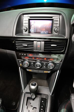 crossover: Front multimedia screen, air-conditioner control and gear lever of new Mazda CX-5 crossover SUV at its launch in Singapore on 13 Apr 2012