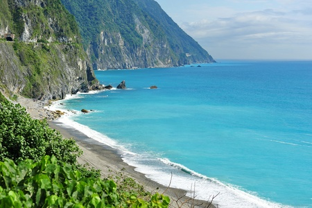 Beautiful east coast of Taiwan with clear blue sea and cliffs photo