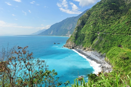 Beautiful east coast of Taiwan with clear blue sea and cliffs 스톡 콘텐츠
