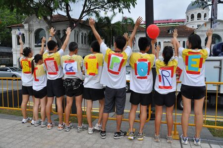 in conjunction: Runners forming word SINGAPORE during Create Action Now   CAN   run in conjunction with Youth Olympic Games logo launch January 10, 2009 in Singapore
