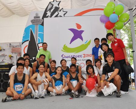 senior olympics: Group photo of Teo Ser Luck, Youth Olympic Games  YOG  Organizing Committee Chairman, Ng Ser Miang and athletes during Singapore YOG logo launch January 10, 2009 in Singapore