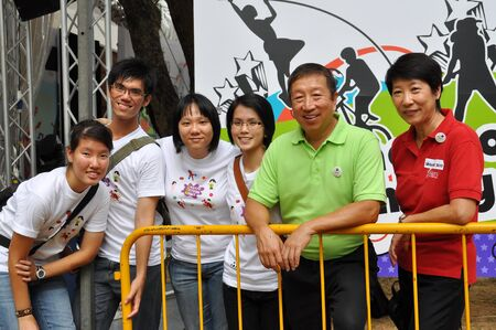 yog: Group photo of Youth Olympic Games  YOG  Organizing Committee Chairman, Ng Ser Miang and Create Action Now event organizers during YOG logo launch January 10, 2009 in Singapore