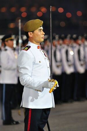 ltc: Parade Commander standing at attention during National Day Parade Singapore 2011 Combined Rehearsal on June 25, 2011 in Singapore