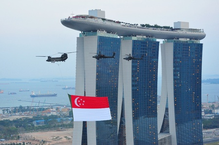 Singapore national flag fly past during National Day Parade Singapore 2011 Combined Rehearsal on July 09, 2011 in Singapore Stock Photo - 13266354