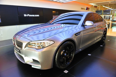 unveil: Unveiling the new BMW M5 Concept at Munich Automobiles BMW Service Centre Open House on May 21, 2011 in Singapore Editorial