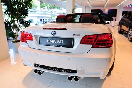 Static display of BMW M3 Coupe at Munich Automobiles BMW Service Centre Open House on May 21, 2011 in Singapore Stock Photo - 13266406
