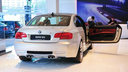 Static display of BMW M3 Coupe at Munich Automobiles BMW Service Centre Open House on May 21, 2011 in Singapore Stock Photo - 13266399