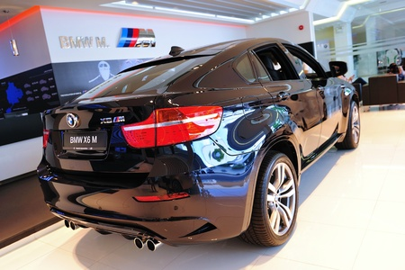 Static display of BMW X6 M at Munich Automobiles BMW Service Centre Open House on May 21, 2011 in Singapore