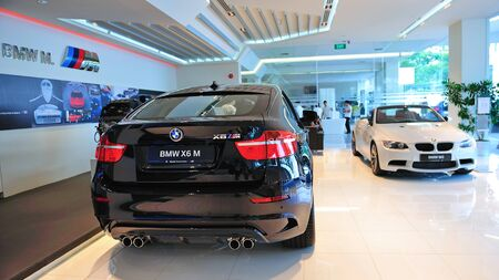 Static display of BMW X6 M and M3 cabriolet at Munich Automobiles BMW Service Centre Open House on May 21, 2011 in Singapore Stock Photo - 13266398