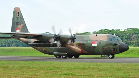 Republic of Singapore Air Force (RSAF) C-130 Hercules military cargo plane taxies during RSAF Open House 2011 on May 28, 2011 in Singapore