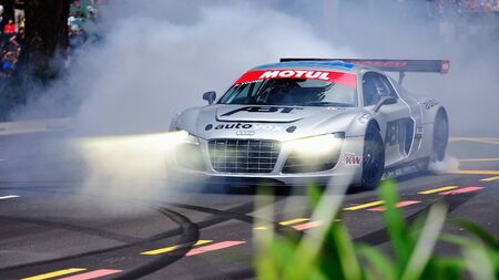Audi R8 LMS performs stunts during Red Bull Speed Street Singapore on April 24, 2011 in Singapore