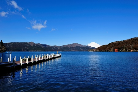 Hakone Lake and Mount Fuji in Japan, with a torii gate from Hakone s shrine at the far end shore of the lake