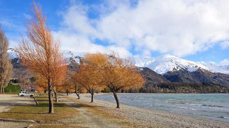 Beautiful Lake Wanaka and surrounding snow mountains in New Zealand photo
