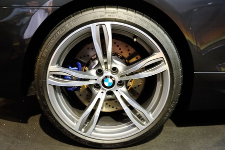 Large wheel alloy and carbon ceramic brake of BMW M6 Convertible at its Preview at Singapore Yacht Show April 28, 2012 in Singapore Stock Photo - 13455460