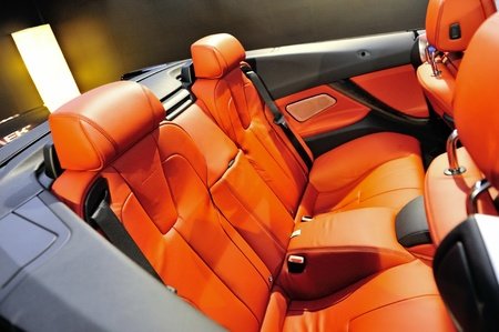 Rear seats with orange leather upholstery in a BMW M6 Convertible at its Preview at Singapore Yacht Show April 28, 2012 in Singapore