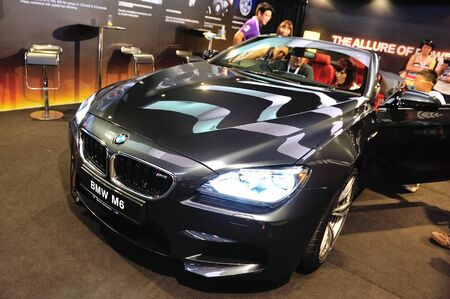 Guests viewing the BMW M6 Convertible at its Preview at Singapore Yacht Show April 28, 2012 in Singapore