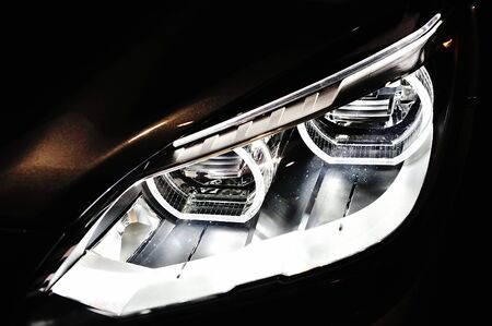 Front adaptive LED head lights of BMW M6 Convertible at its Preview at Singapore Yacht Show April 28, 2012 in Singapore Éditoriale