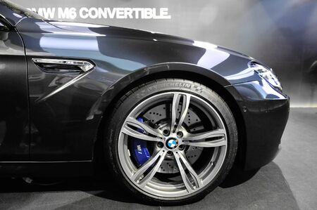 Bonnet and large alloy wheel of BMW M6 Convertible at its Preview at Singapore Yacht Show April 28, 2012 in Singapore