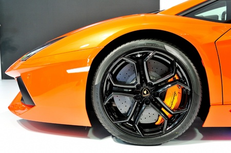 Bonnet and wheel with carbon ceramic brake of Lamborghini Aventador LP 700-4 at Singapore Yacht Show April 28, 2012 in Singapore Editorial