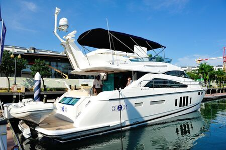 Fairline Squadron luxury yacht on display at Singapore Yacht Show April 28, 2012 in Singapore Stock Photo - 13574735