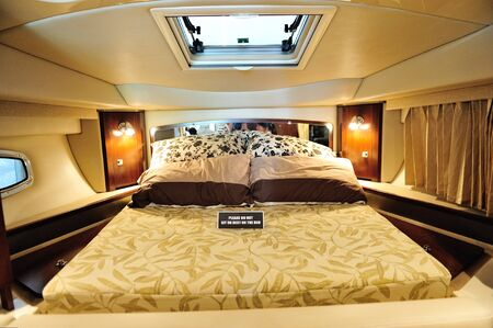 Bed in a Chaparral 310 cruiser at Singapore Yacht Show April 28, 2012 in Singapore Stock Photo - 13574742