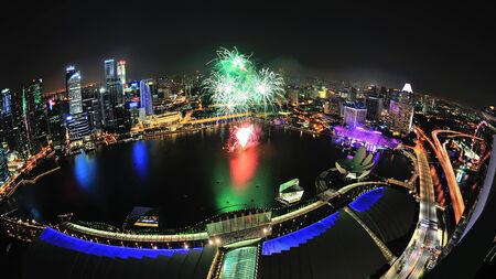 Aerial view of fireworks display with Marina Bay city scape during National Day Parade 2012 Preview on August 04, 2012 in Singapore