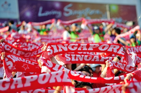scarves: Sea of Singapore scarves during National Day Parade 2012 on August 09, 2012 in Singapore