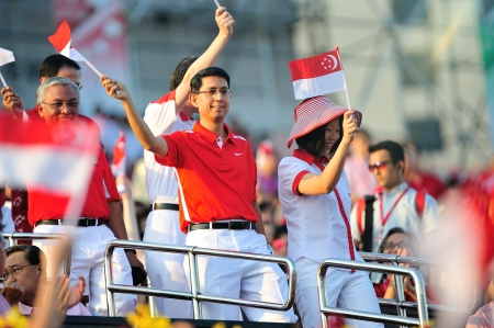 Ministers of State waving flags during National Day Parade 2012 on August 09, 2012 in Singapore