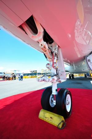 chock: Nose wheel of a private jet at Singapore Airshow February 03, 2010 in Singapore
