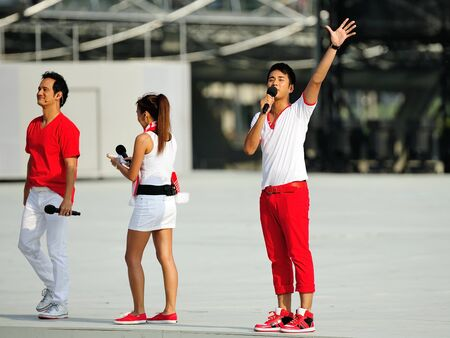 gomez: Event host Joakim Gomez waving to the audience during National Day Parade 2012 on August 09, 2012 in Singapore