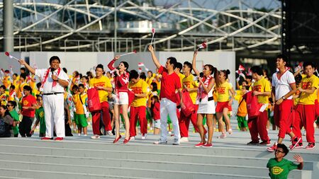 gomez: Event hosts Suhami Yusof, Sharon Au, Gurmit Singh, Jean Danker and Joakim Gomez speaking to the audience during National Day Parade 2012 on August 09, 2012 in Singapore  Editorial