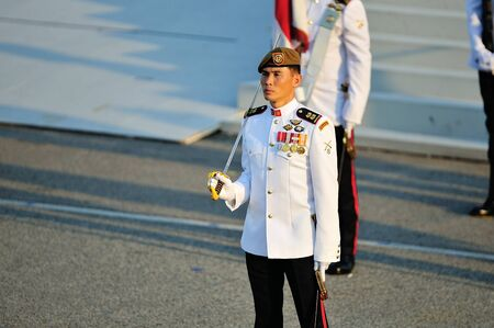 Parade Commander LTC Clarence Tan leading the parade ceremony during National Day Parade 2012 on August 09, 2012 in Singapore