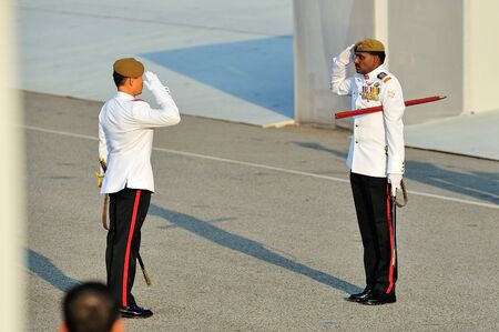 ltc: Parade Regimental Sergeant Major MWO Kannan Tamizh saluting Parade Commander LTC Clarence Tan during National Day Parade 2012 on August 09, 2012 in Singapore Editorial
