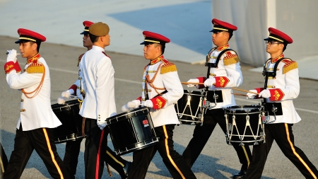 ltc: Military band drumming to the Parade Commander LTC Clarence Tan during National Day Parade 2012 on August 09, 2012 in Singapore