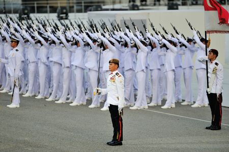 commanding: Parade Commander LTC Clarence Tan commanding feu de joie during National Day Parade 2012 on August 09, 2012 in Singapore